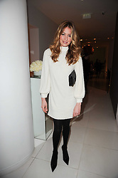 CAT DEELEY at a party to celebrate Lancome's 10th anniversary of sponsorship of the BAFTA's in association with Harper's Bazaar magazine held at St.Martin's Lane Hotel, London on 19th February 2010.