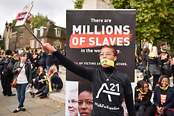 "© Licensed to London News Pictures. 14/10/2107. London, UK. People prepare to take part in the ""The Walk For Freedom"", marching around the capital demonstrating against modern slavery.  The protest is co-ordinated with other walks which abolitionist group A21 is staging in 400 cities around the world on the same day. The facemasks represents the silence of modern slaves. Photo credit : Stephen Chung/LNP"