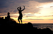 Locals dance during sunset on Nosy Be. The Magical Experience of a boat charter from Nosy Be, Madagascar. Madagascat Charters offer the full range of services. All Images by Greg Beadle. Copyright, www.beadlephoto.com