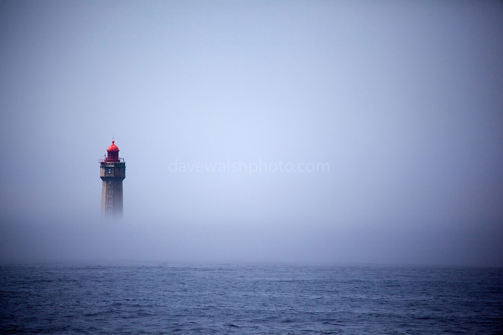 """The dramatic La Jument lighthouse, shrounded in summer fog, off the coast of the Ile d'Ouessant, Brittany. The iconic 47-metre high lighthouse was built between 1904 and 1911 in a particular treacherous part of the Brittany coastline. This mage can be licensed via Millennium Images. Contact me for more details, or email mail@milim.com For prints, contact me, or click """"add to cart"""" to some standard print options."""