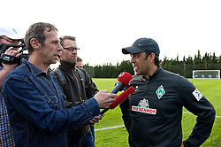 11.01.2014, Trainingsplatz, Jerez de la Frontera, ESP, 1. FBL, SV Werder Bremen, Trainingslager, im Bild Robin Dutt (Cheftrainer SV Werder Bremen) beim Interview nach der ersten Trainingseinheit // Robin Dutt (Cheftrainer SV Werder Bremen) beim Interview nach der ersten Trainingseinheit during Trainingsession of German Bundesliga Club SV Werder Bremen at Trainingsplatz in Jerez de la Frontera, Spain on 2014/01/11. EXPA Pictures © 2014, PhotoCredit: EXPA/ Andreas Gumz<br /> <br /> *****ATTENTION - OUT of GER*****