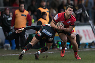 Damien Hoyland of Edinburgh is tackled by Angus O'Brien of the Newport Gwent Dragons. Guinness Pro12 rugby match, Newport Gwent Dragons  v Edinburgh rugby at Rodney Parade in Newport, South Wales on Sunday 27th November 2016.<br /> pic by Simon Latham, Andrew Orchard sports photography.