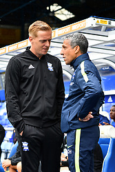 """Brighton & Hove Albion manager Chris Hughton and Birmingham City manager Garry Monk during the pre-season friendly match at the St Andrew's Trillion Trophy Stadium, Birmingham. PRESS ASSOCIATION Photo. Picture date: Saturday July 28, 2018. See PA story SOCCER Birmingham. Photo credit should read: Anthony Devlin/PA Wire. RESTRICTIONS: EDITORIAL USE ONLY No use with unauthorised audio, video, data, fixture lists, club/league logos or """"live"""" services. Online in-match use limited to 75 images, no video emulation. No use in betting, games or single club/league/player publications."""
