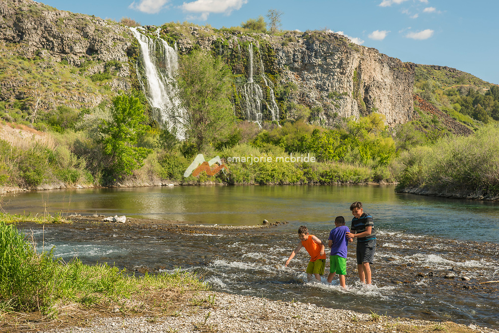 Kids playing in water at Ritter Island along the Snake River in Hagerman, Idaho.