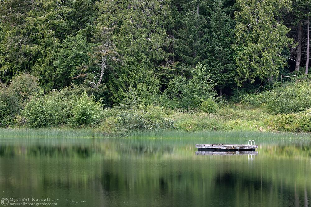A swimming platform floating on St. Mary Lake on Salt Spring Island, British Columbia, Canada