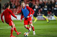 Wales midfielder Lee Evans warms up during the Friendly European Championship warm up match between Wales and Trinidad and Tobago at the Racecourse Ground, Wrexham, United Kingdom on 20 March 2019.