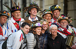 """© Licensed to London News Pictures. 01/05/2018. Oxford, UK. Morris dancers in dress pose for a photograph with tourists as they prepare to dance next to Hertford Bridge, often called """"the Bridge of Sighs"""" in Oxford, Oxfordshire as part of May Day celebrations. Students were again prevented from jumping from Magdalen Bridge in to the river, which has historically been a tradition, due to injuries at a previous years event . Photo credit: Ben Cawthra/LNP"""