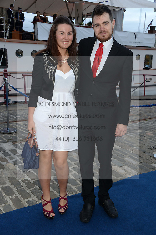 Johnnie Walker Gold Label Reserve Finale Celebration Party aboard the John Walker & Sons Voyager moored at the Prince of Wales Docks, Leith, Edinburgh, Scotland on 14th August 2013.<br /> Picture shows:-Claire McPherson and Ryan Bradley.