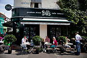 Bill's cafe, a well known  and popular place for tourists on the High Street in East Sussex's famous town of Lewes. Lewes is the county town of East Sussex, England, a civil parish and is the centre of the Lewes local government district. The settlement has a history as a bridging point and as a market town, and today as a communications hub and tourist-orientated town. At the 2001 census it had a population of 15,988
