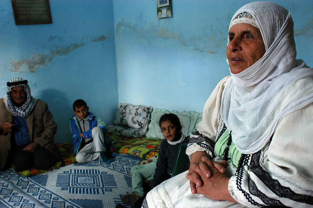 Um Rushdi Toumeh, mother of 16, sits in her home in the northern West Bank village of Qaffin, with husband, Abu Rushdi, left and two grandchildren, on Eid, the final day of Ramadan...Photo by Erin Lubin