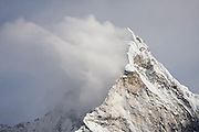 A plume of spindrift snow curls off the summit ridge of Ama Dablam (6848m), as seen from Chhukung Ri (a side trip off the Everest Base Camp trek), Khumbu region, Sagarmatha National Park, Himalaya Mountains, Nepal.