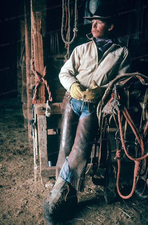 Cowboy in the stable at the Spanish Ranch in Nevada.