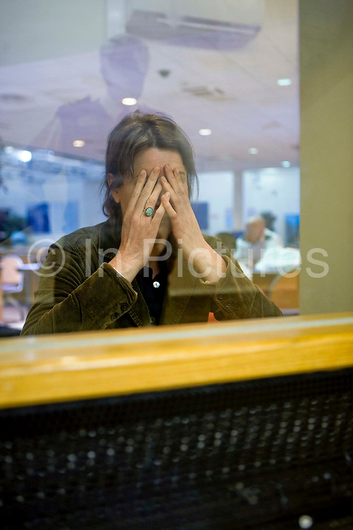 A visitor becomes emotional as she talks to one of the prisoners from behind a glass security screen. HMP Wandsworth, London, United Kingdom. Families can visit prisoners every Monday afternoon from 13.30 - 16.30. There are no visits on Christmas Day, Boxing Day or Good Friday. The number and duration of visits depends on the prisoner's privilege level, which he earns by his behaviour.