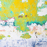 A close up of a colorful pastel wall in Mexico creates an abstract vertical image.