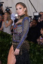 Jennifer Lopez walking the red carpet at The Metropolitan Museum of Art Costume Institute Benefit celebrating the opening of Heavenly Bodies : Fashion and the Catholic Imagination held at The Metropolitan Museum of Art  in New York, NY, on May 7, 2018. (Photo by Anthony Behar/Sipa USA)