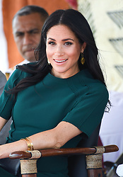 Prince Harry Duke of Sussex and Meghan Duchess of Sussex attend an official welcome ceremony to Nadi and unveiling of the Labalaba Statue at Nadi Airport, Suva, Fiji. Photo credit should read: Doug Peters/EMPICS