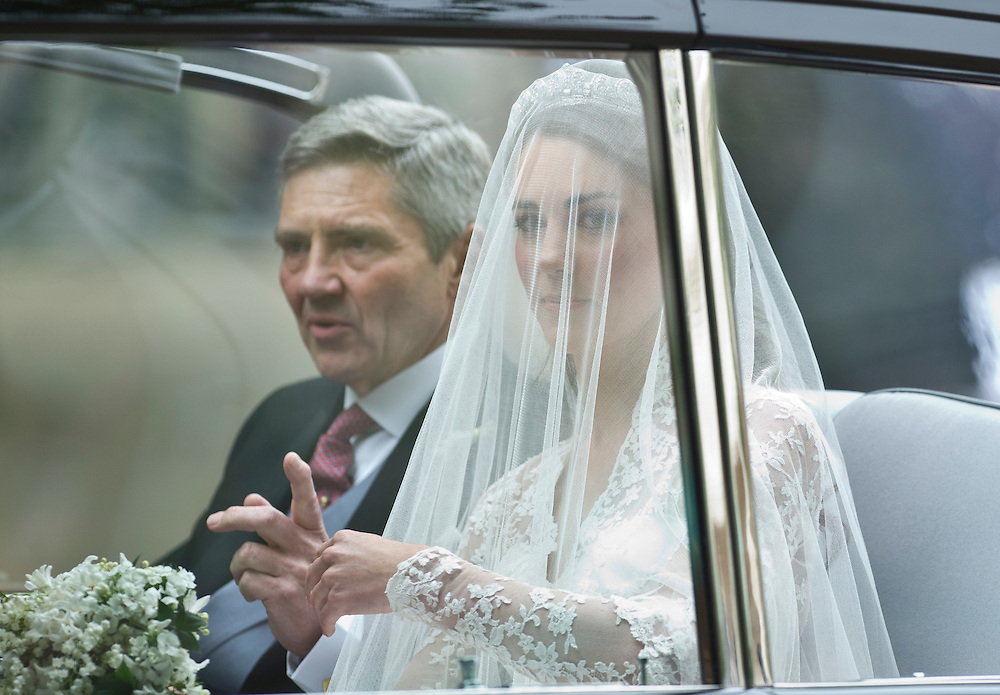 Kate Middletonis and her father make their way to the Westminster abbey for the Royal Wedding in London Friday, April, 29, 2011. (AP Photo/Bogdan Maran)