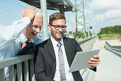 Two business partners looking at tablet computer