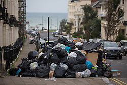 © Licensed to London News Pictures.  18/10/2021. Brighton, UK. Uncollected rubbish pile up on the streets of Brighton in East Sussex as the ongoing bin dispute between the GMB and the council continues. Photo credit: Marcin Nowak/LNP