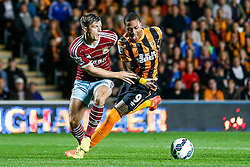Hull City's record new signing Abel Hernandez, making his club debut, is challenged by Aaron Cresswell of West Ham - Photo mandatory by-line: Rogan Thomson/JMP - 07966 386802 - 15/09/2014 - SPORT - FOOTBALL - KC Stadium, Hull - Hull City v West Ham United - Barclays Premier League.