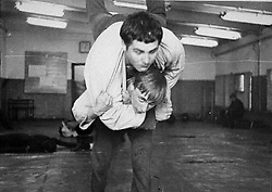 Before rising to power as one of the most infamous leaders in the world, Putin was a playful, hipster-dressing man in love. 1971 - St. Petersburg, Russia - Young VLADIMIR PUTIN, bottom, wrestles with a classmate at the St. Petersburg Sports School. (Credit Image: © Russian Archives via ZUMA Wire)