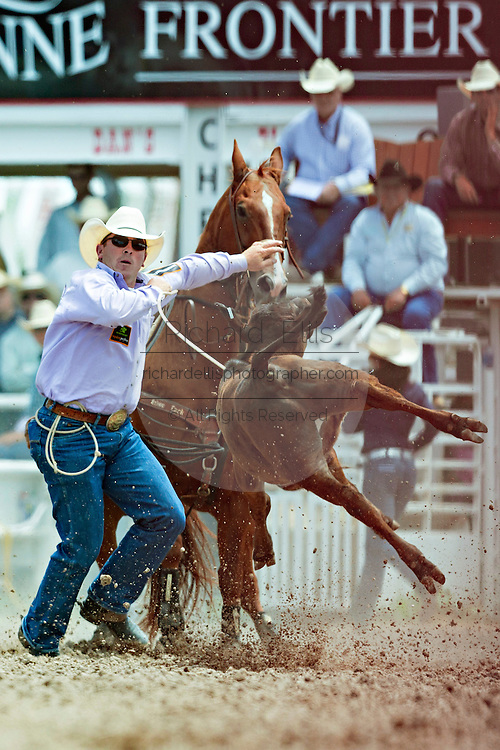 Steer roper Ryan Jarrett during the Steer Roping finals at the Cheyenne Frontier Days rodeo in Frontier Park Arena July 26, 2015 in Cheyenne, Wyoming.