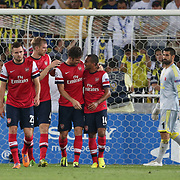 Fenerbahce's Volkan Demirel (R) and Arsenal's (L-R) 	Jenkinson, Mertesacker, Olivier Giroud, Walcott<br /> Substitution during the UEFA Champions League Play-Offs First leg soccer match Fenerbahce between Arsenal at Sukru Saracaoglu stadium in Istanbul Turkey on Wednesday 21 August 2013. Photo by Aykut AKICI/TURKPIX