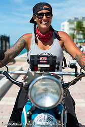 Jody Perewitz  with her 1936 Harley-Davidson VLH after crossing the finish line at the end of the Cross Country Chase motorcycle endurance run from Sault Sainte Marie, MI to Key West, FL. (for vintage bikes from 1930-1948). The Grand Finish in Key West's Mallory Square after the 110 mile Stage-10 ride from Miami to Key West, FL and after covering 2,368 miles of the Cross Country Chase. Sunday, September 15, 2019. Photography ©2019 Michael Lichter.