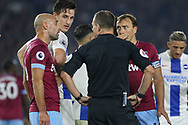 West Ham United defender Pablo Zabaleta (5) and West Ham United midfielder Mark Noble (16) argues with Referee Kevin Friend Brighton and Hove Albion defender Lewis Dunk (5) looks on during the Premier League match between Brighton and Hove Albion and West Ham United at the American Express Community Stadium, Brighton and Hove, England on 5 October 2018.