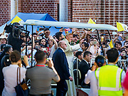 30 NOVEMBER 2017 - YANGON, MYANMAR: POPE FRANCIS is driven through the crowd at the Cathedral during the Papal Mass at St. Mary's Cathedral in Yangon. Thursday's mass was his last public appearance in Myanmar. From Myanmar the Pope went on to neighboring Bangladesh.    PHOTO BY JACK KURTZ