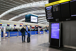 © Licensed to London News Pictures. 09/09/2019. London, UK. A man arrives at Heathrow Terminal 5 departures  which is completely empty as tens of thousands of British Airways passengers face disruption on the first day of the two days first-ever strike staged by British Airways pilots dispute over pay. British Airways had requested its passengers that they were unlikely to travel and to make alternative arrangements prior to the strike action. Photo credit: Dinendra Haria/LNP
