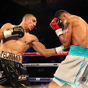 NEW ORLEANS, LA - JULY 14:  Teofimo Lopez punches William Silva during their WBC Continental Americas Title boxing match at the UNO Lakefront Arena on July 14, 2018 in New Orleans, Louisiana.  (Photo by Alex Menendez/Getty Images) *** Local Caption *** Teofimo Lopez; William Silva