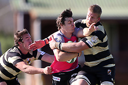 Emile Temperman of the Pumas is tackled by Theuns Kotze of Boland and Jacques Engelbrecht of Boland during the Currie Cup premier division match between the Boland Cavaliers and The Pumas held at Boland Stadium, Wellington, South Africa on the 2nd September 2016<br /> <br /> Photo by:   Shaun Roy/ Real Time Images