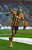 Hull City's Josh Magennis celebrates scoring his team's v4th goal<br /> <br /> Photographer Dave Howarth/CameraSport<br /> <br /> The EFL Sky Bet League One - Wigan Athletic v Hull City - Wednesday 17th February 2021 - DW Stadium - Wigan<br /> <br /> World Copyright © 2021 CameraSport. All rights reserved. 43 Linden Ave. Countesthorpe. Leicester. England. LE8 5PG - Tel: +44 (0) 116 277 4147 - admin@camerasport.com - www.camerasport.com