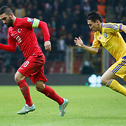 Turkey's Arda Turan (L) during their UEFA Euro 2016 qualification Group A soccer match Turkey betwen Kazakhstan at AliSamiYen Arena in Istanbul November 16, 2014. Photo by Kurtulus YILMAZ/TURKPIX
