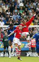 Photo: Chris Ratcliffe.<br />Charlton Athletic v Chelsea. The Barclays Premiership. 17/09/2005.<br />Didier Drogba of Chelsea goes up with Danny Murphy centre and Chris Perry of Charlton