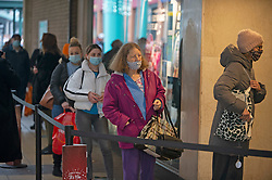 © Licensed to London News Pictures. 10/12/2020. <br /> Bexleyheath, UK. Christmas shoppers queuing outside the M&S Food hall, Bexleyheath Broadway in the London borough of Bexley today. London is under threat of going into tier three as the Coronavirus infection rate increases across more than twenty London Boroughs. Photo credit:Grant Falvey/LNP