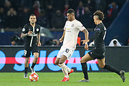 Manchester United Forward Marcus Rashford battles with Thilo Kehrer of Paris Saint-Germain during the Champions League Round of 16 2nd leg match between Paris Saint-Germain and Manchester United at Parc des Princes, Paris, France on 6 March 2019.