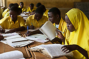 The older pupils studying for there KCP exam at Mwakirunge School, Nr Mombassa, Kenya. There are 800 pupils in the school and 17 teachers in 11 classrooms. The Wema centre have provided the school with, scout uniforms, books, sanitary pads and 100 solar lamps to help improve schoolwork. Wema is an NGO organisation supporting vulnerable children.