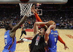 March 8, 2019 - Los Angeles, California, U.S - Los Angeles Clippers' Danilo Gallinari (8) goes to basket while defended by Oklahoma City Thunder's Russell Westbrook (0) and Oklahoma City Thunder's Jerami Grant (9) during an NBA basketball game between Los Angeles Clippers and Oklahoma City Thunder Friday, March 8, 2019, in Los Angeles. (Credit Image: © Ringo Chiu/ZUMA Wire)