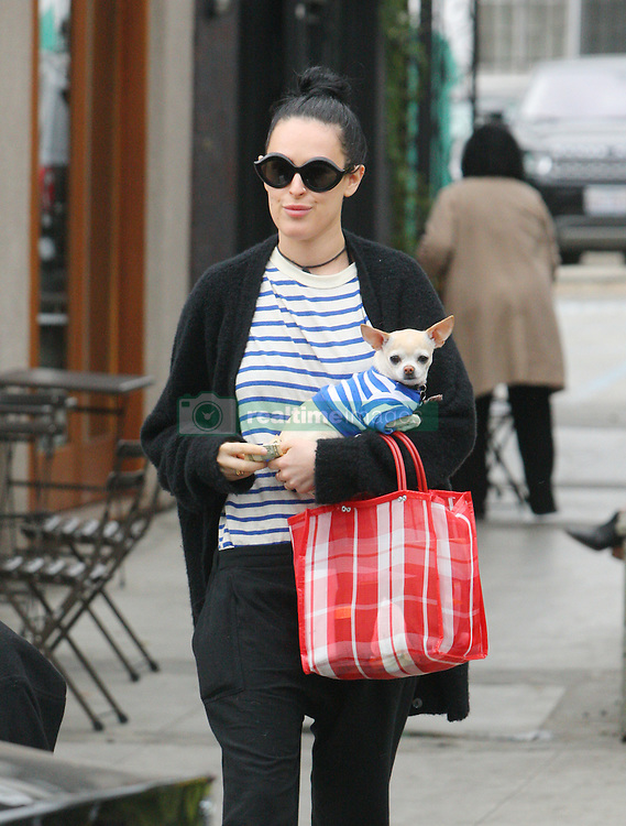 EXCLUSIVE: Rumer Willis comes out with unique hair do, she has shaved part of the hair on the back of her head. She wears a blue and white striped shirt, that matches with her pet chihuahua!. 10 May 2017 Pictured: Rumer Willis. Photo credit: KISS / MEGA TheMegaAgency.com +1 888 505 6342