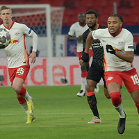 Dani Olmo (L) of RB Leipzig and Christopher Nkunku (R) of RB Leipzig runs for the ball during the UEFA Champions League Round of 16 First Leg Football match between RB Leipzig and Liverpool FC in Budapest, Hungary on Feb. 16, 2021. ATTILA VOLGYI