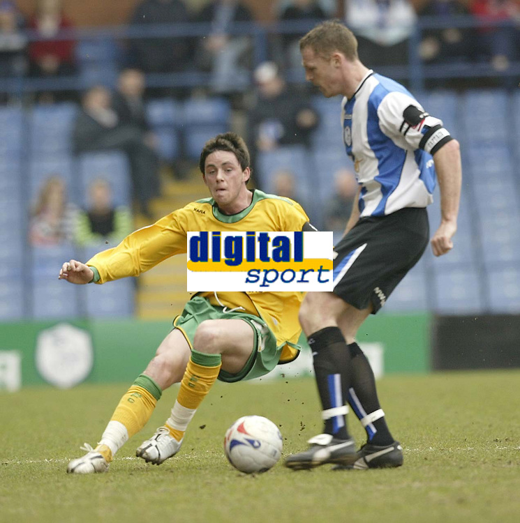 Photo: Aidan Ellis.<br /> Sheffield Wednesday v Norwich City. Coca Cola Championship. 15/04/2006.<br /> Norwich's Ian Henderson was booked for this challenge on Sheffield's Graham Coughlan