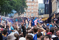 © Licensed to London News Pictures.  18/06/2021. London, UK. Scottish football supporters gather at Leicester Square, central London ahead of their EURO 2020 match against England at Wembley this evening. Photo credit: Marcin Nowak/LNP