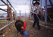 06 AUGUST 2000 - WILLIAMS, AZ:  A young cowboy prays before competing at the 22nd Annual Cowpunchers' Reunion Rodeo in Williams, Arizona, Aug 6.  The Cowpunchers' Reunion Rodeo is held for working cowboys from the ranches in Arizona and the region. PHOTO BY JACK KURTZ