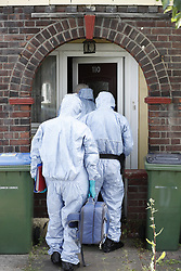 © Licensed to London News Pictures. 24/06/2018. London, UK. Forensics officers are seen at a property in Greenwich after the body of a woman in her 50s was found in the back garden yesterday. Photo credit: Peter Macdiarmid/LNP