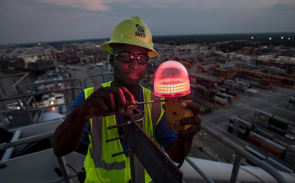 Ship to shore crane maintenance personnel change a light at the Georgia Ports Authority Garden City Terminal, Thursday, August 14, 2014, in Savannah, Ga.  (GPA Photo/Stephen B. Morton)