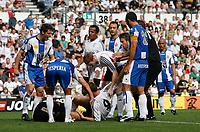 Photo: Steve Bond.<br />Derby County v RCD Espanyol. Pre Season Friendly. 04/08/2007. Players untangle Steve Howard (ground R) and injured keeper Gorka Iraizoz