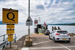 Passengers and cars embarking onto Caledonian Macbrayne ferry at Claonaig on Kintyre Peninsula from Lochranza on Arran in Scotland UK