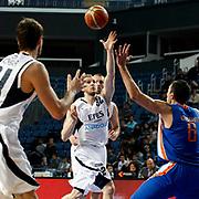Efes Pilsen's Sinan GULER (C) during their Turkish Basketball league match Efes Pilsen between Mersin BSB at the Sinan Erdem Arena in Istanbul Turkey on Saturday 19 March 2011. Photo by TURKPIX